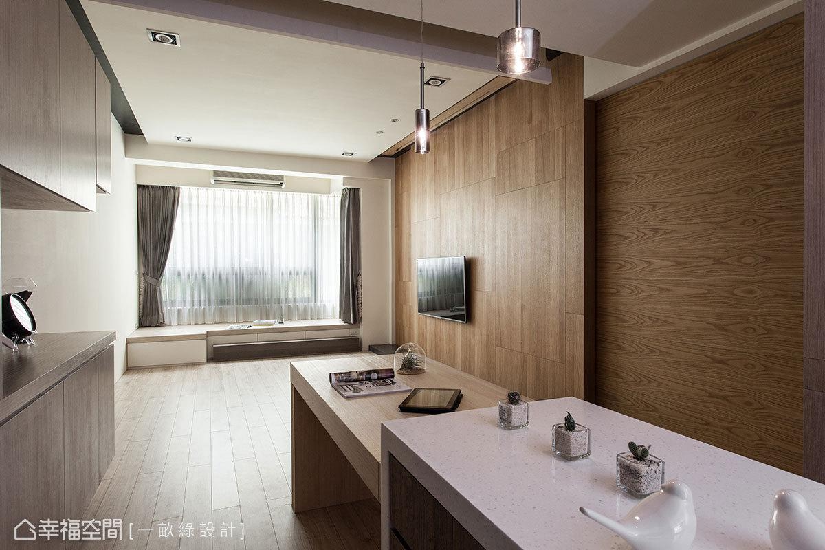 中島接續餐桌線條,目光向後遞延臥榻與窗外,形塑層疊向下與延伸拉長的視野層次。