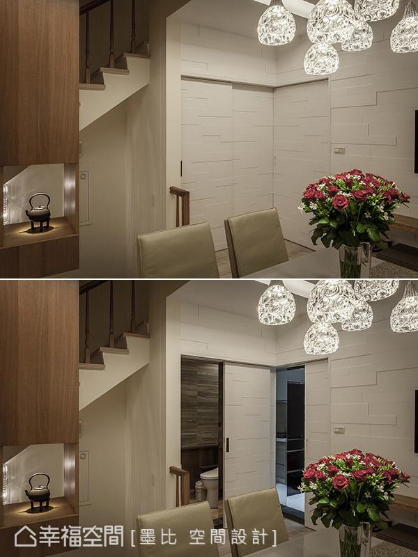 立體切割的造型板立面內分別隱藏通往廚房與客衛浴門片,保留空間簡潔的一致性美好。