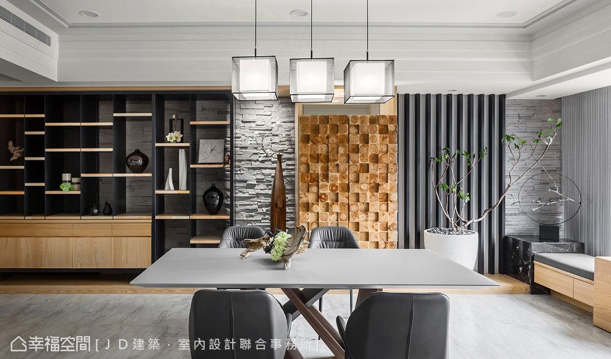 以灰色文化石砌疊的牆面為底,依序陣列鐵件、天然木芯飾板與開放展示層架,構築豐富搶眼的視覺享受。