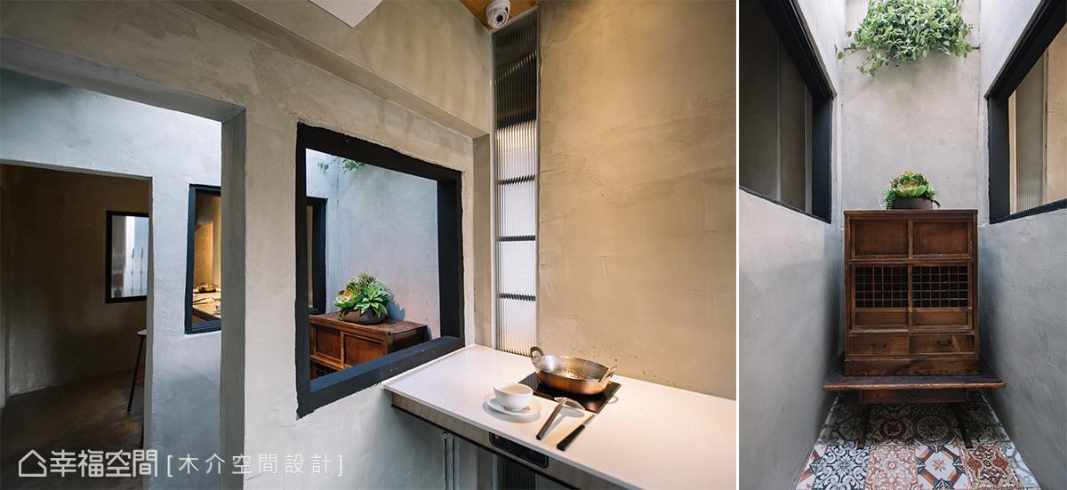 保留原先兩棟房屋中間的天井與門框,將光線引援入室,讓狹小的室內空間具有趣味層次。