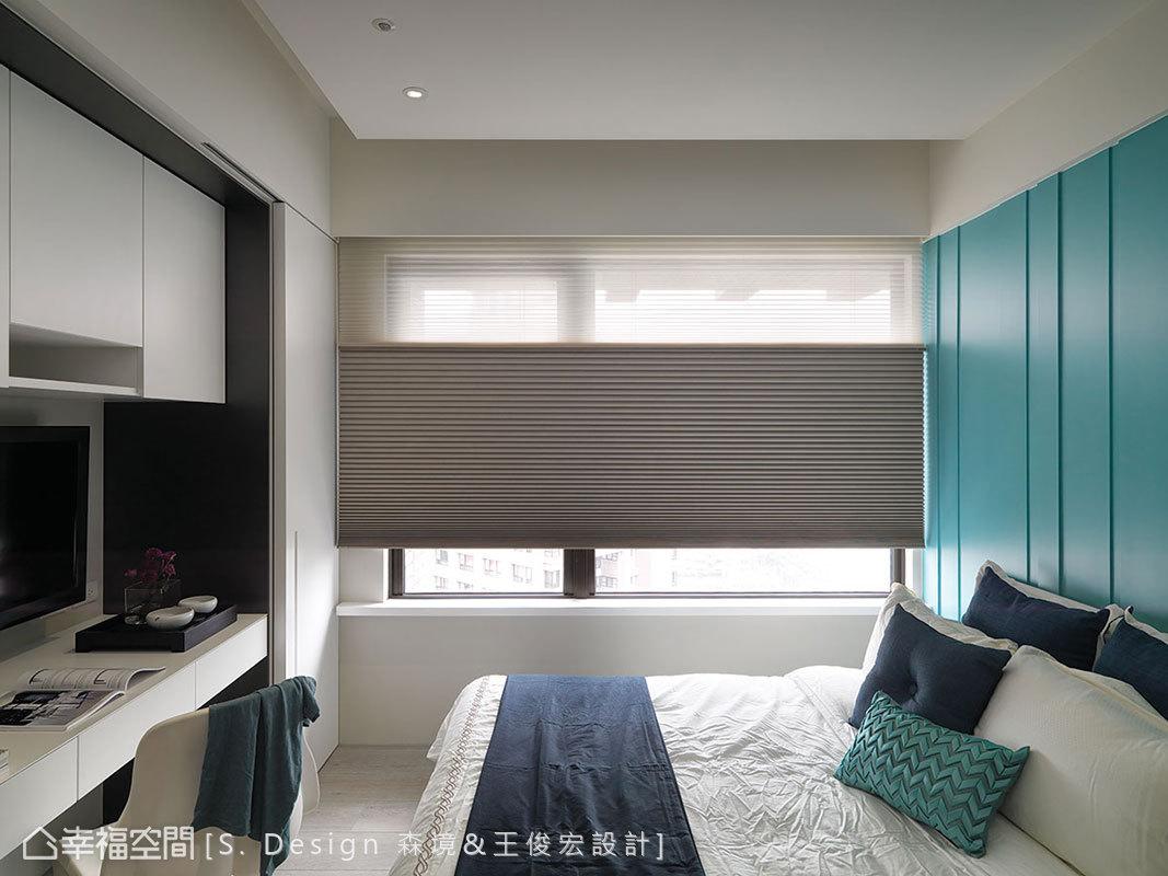 白色與tiffany藍圍塑的女孩房中,以深淺刻劃的俐落線條一呈現代感。