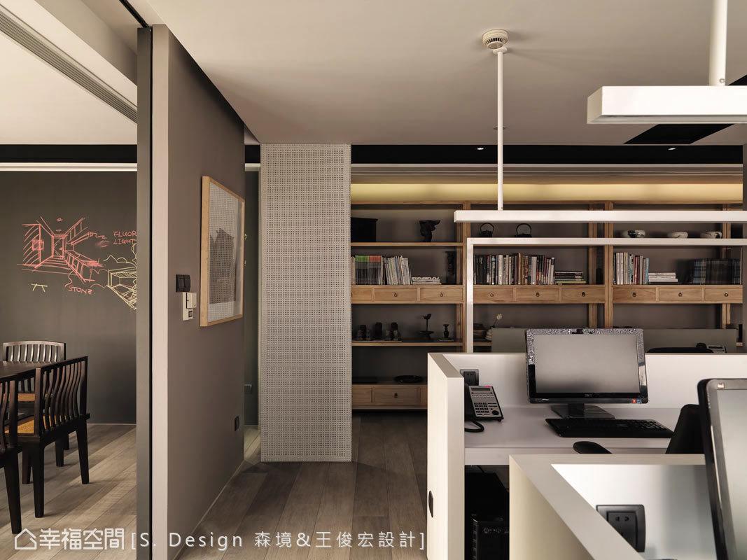 辦公區運用水平與垂直線條,將員工座位清楚劃分,鋪述出屬於當代的設計意象。