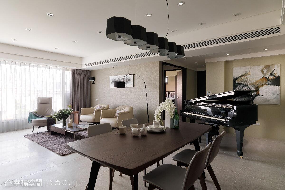 在開放式的公共空間中,家具的深淺色對比界定出客餐廳的不同機能。