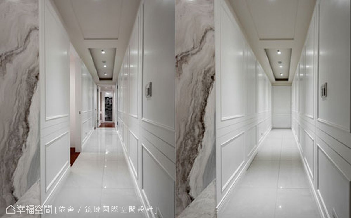 從敞朗大器的公共空間轉入私人場域,廊道上的門面均用隱藏設計,並以新古典的線條勾勒立面線板,增添視覺上的層次感。