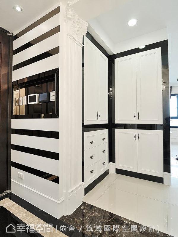 為提升居家隱密而設計的收納區,以黑玻和白色線板創造出視覺上的浮空感。