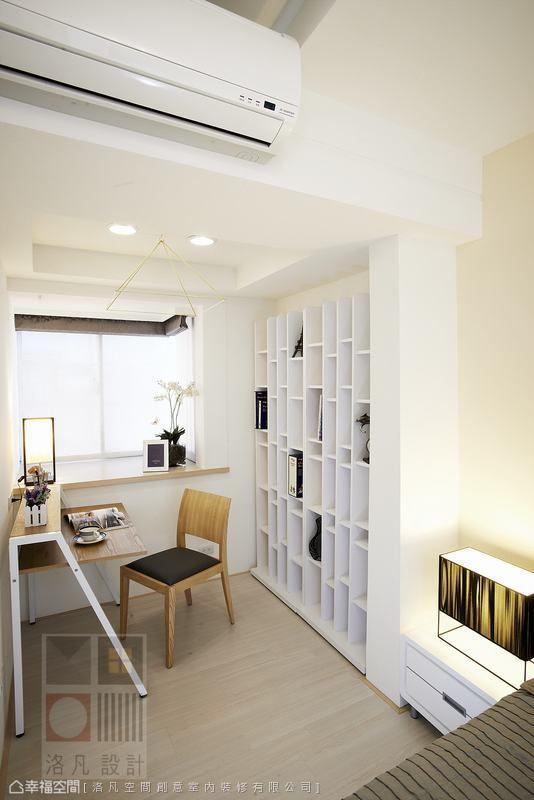 充滿幾何變化的櫃子,不但具有實用的功能,亦是房內的主題造型。