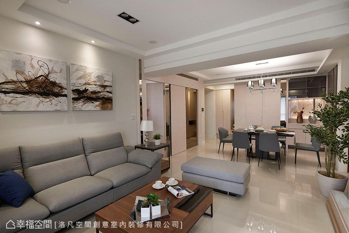 大理石白牆面帶點灰色調,呈現男主人喜愛的風格;牆角邊緣運用茶鏡收邊,串聯起客餐廳立面表情。