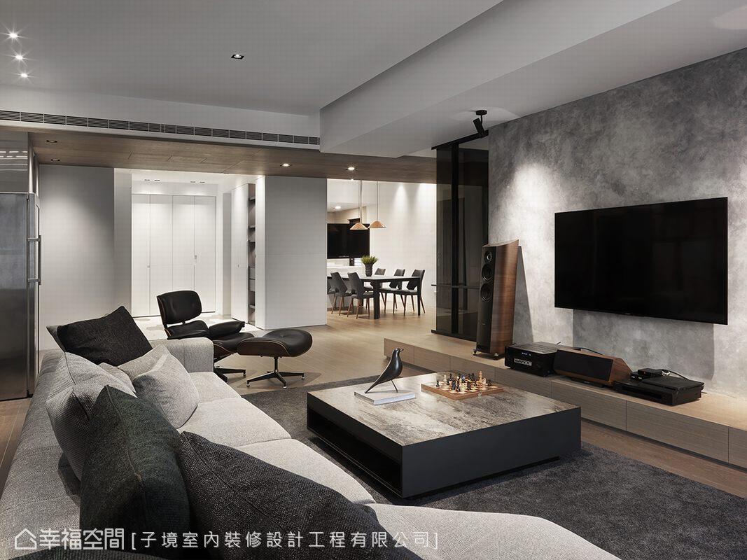不刻意做滿的電視牆,子境空間設計以漸層色特殊塗料為底,增添空間的現代質感,實現屋主對簡約生活之期待。