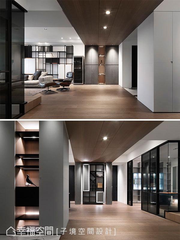 天花以木皮貫穿場域,兩端牆面皆設置櫃體,靠客廳一側為大型物品收納櫃,另一側則為紅酒展示櫃。