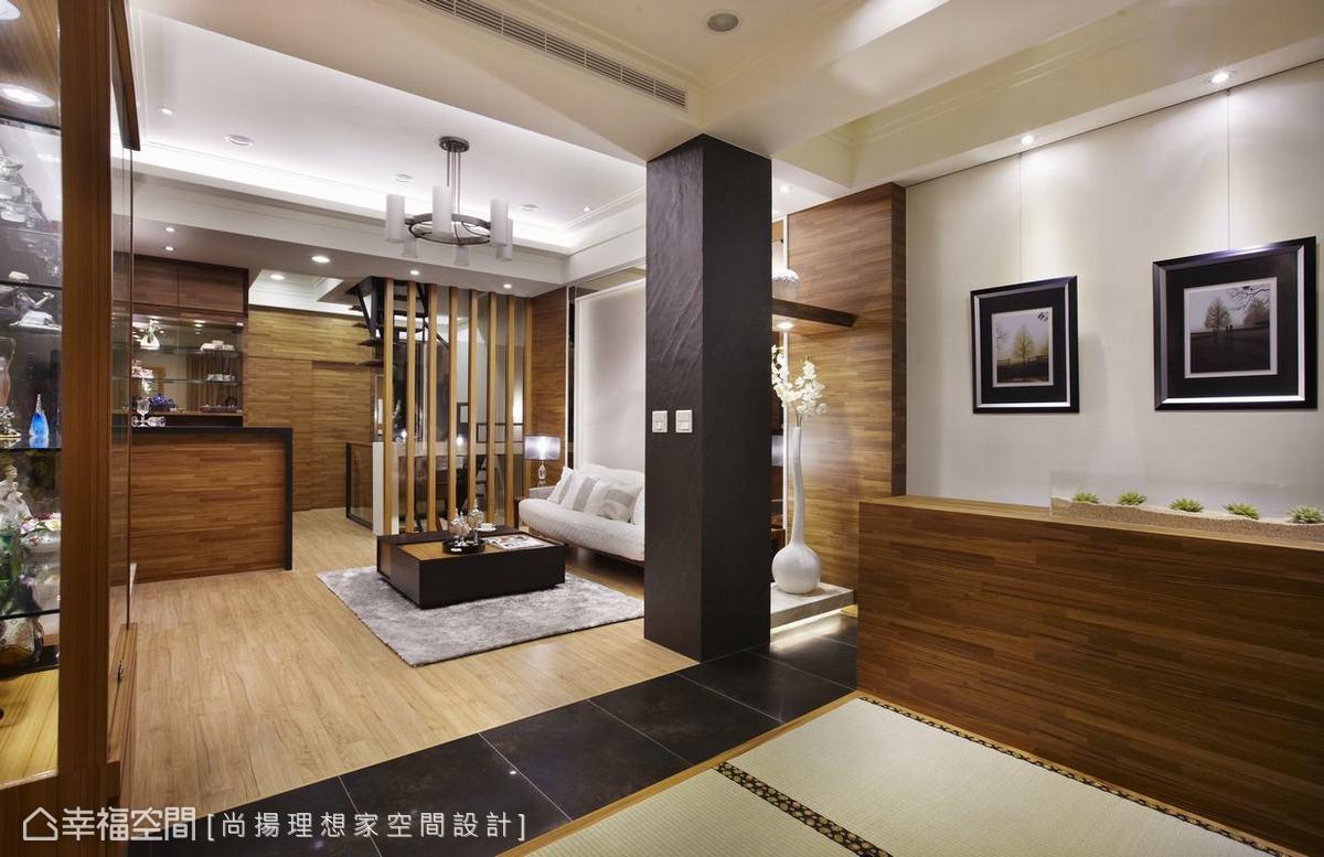 地面材質以鏽石磚延伸入內,銜接客廳的木地板成為轉換空間屬性的界定。