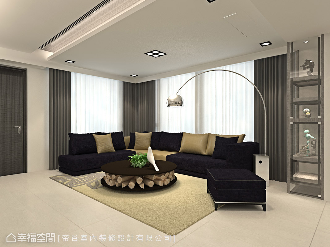 深藍色短絨布材質織就沙發外衣,讓現代感的空間更添一股摩登風采。