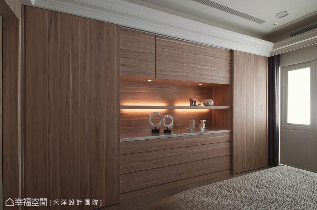 延續溫暖的木紋語彙,讓房間也充滿寧靜舒適的空間感。