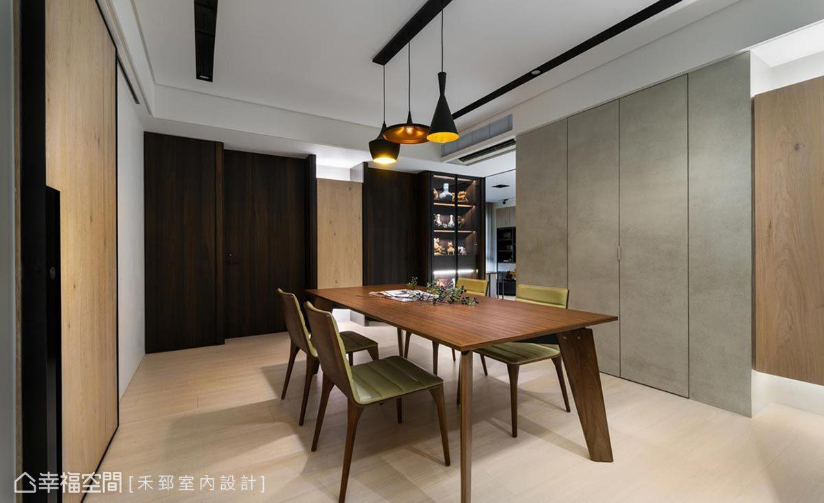 餐廳右側背牆以清水膜塗料表現自然純粹意象,並將通往儲藏間的門片藏於壁面中,維持簡潔俐落的視覺感受。