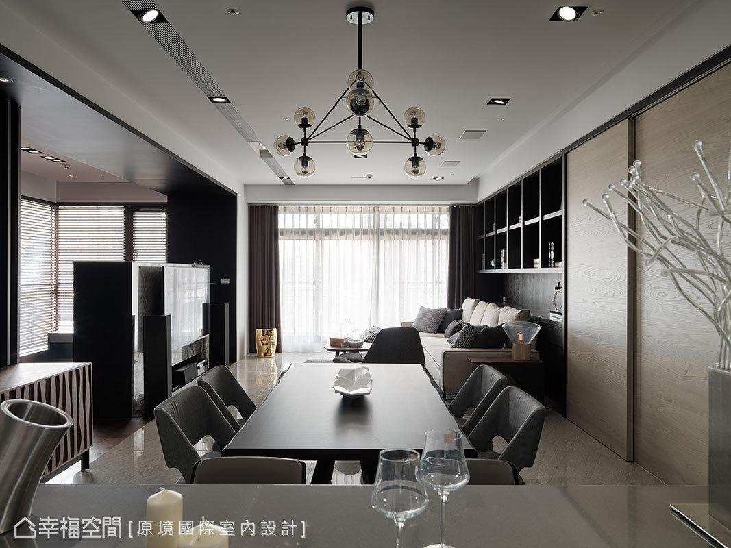 重整後的格局,將客廳、餐廳與中島廚房安排在水平動線上,可從容照顧每一個家庭成員並增進互動。