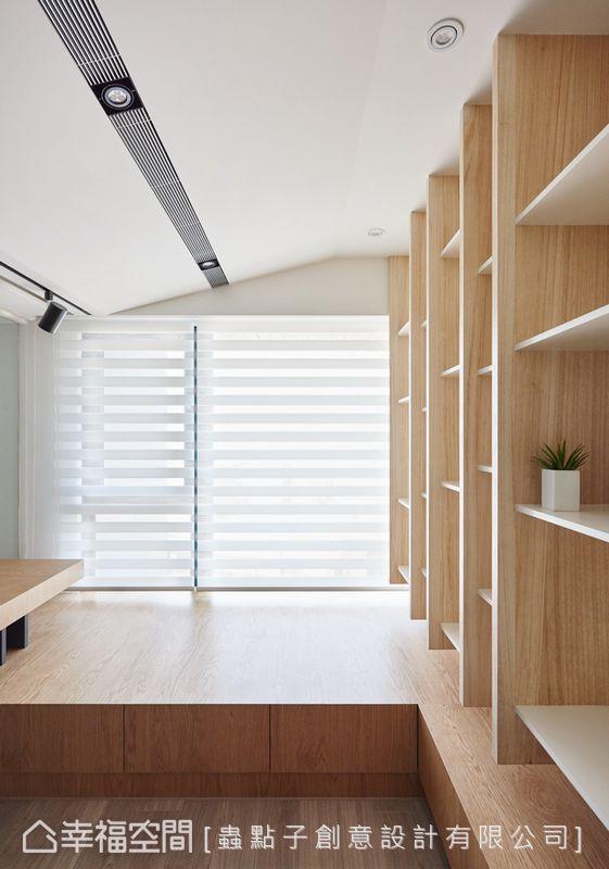 以木作方式將機能整合,讓臥榻、書桌、櫃子相互結合,創造出一體成型的設計。