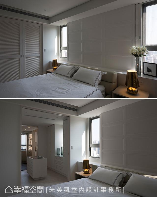 設置半高背櫃讓床頭避開樑下空間,以比例勻稱的訂製線板,展現方框序列下的線條之美。立面使用隱藏拉門設計,除了遮蔽床頭兩側的窗框外,也隱藏更衣室入口動線。