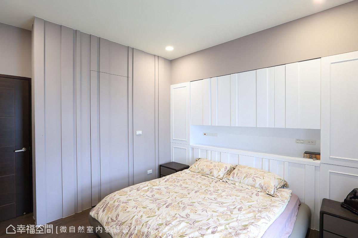 壁面與床頭櫃造型,飾以不規則的立面線條,創造出視覺層次與獨特的韻律感。
