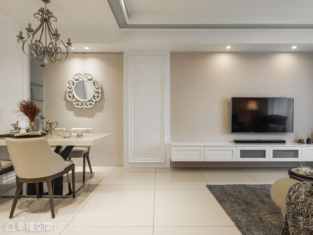 透過造型天花及壁面線板作為分隔,右側客廳以簡單明亮為主調,左側餐廳則利用燈飾及鏡子添加優雅氣氛。