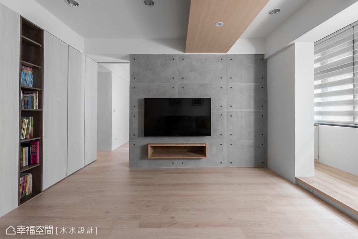 一道灰色清水模牆形成室內視覺焦點,而這道量體在木地板與素白天花映襯下得到一種和諧相容又不失特色的詮釋。