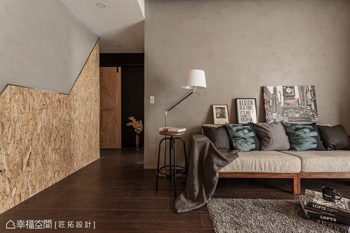壁面選用帶有水泥粉光質感的特殊塗料鋪陳,營造出樸質內斂的場域基調。