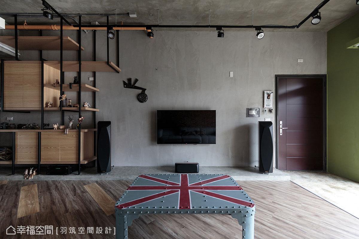 以英倫風的格紋圖案為概念,地坪以超耐磨木地板做斜紋拼貼,電視牆下墊高的音響檯面則使用水泥粉光。