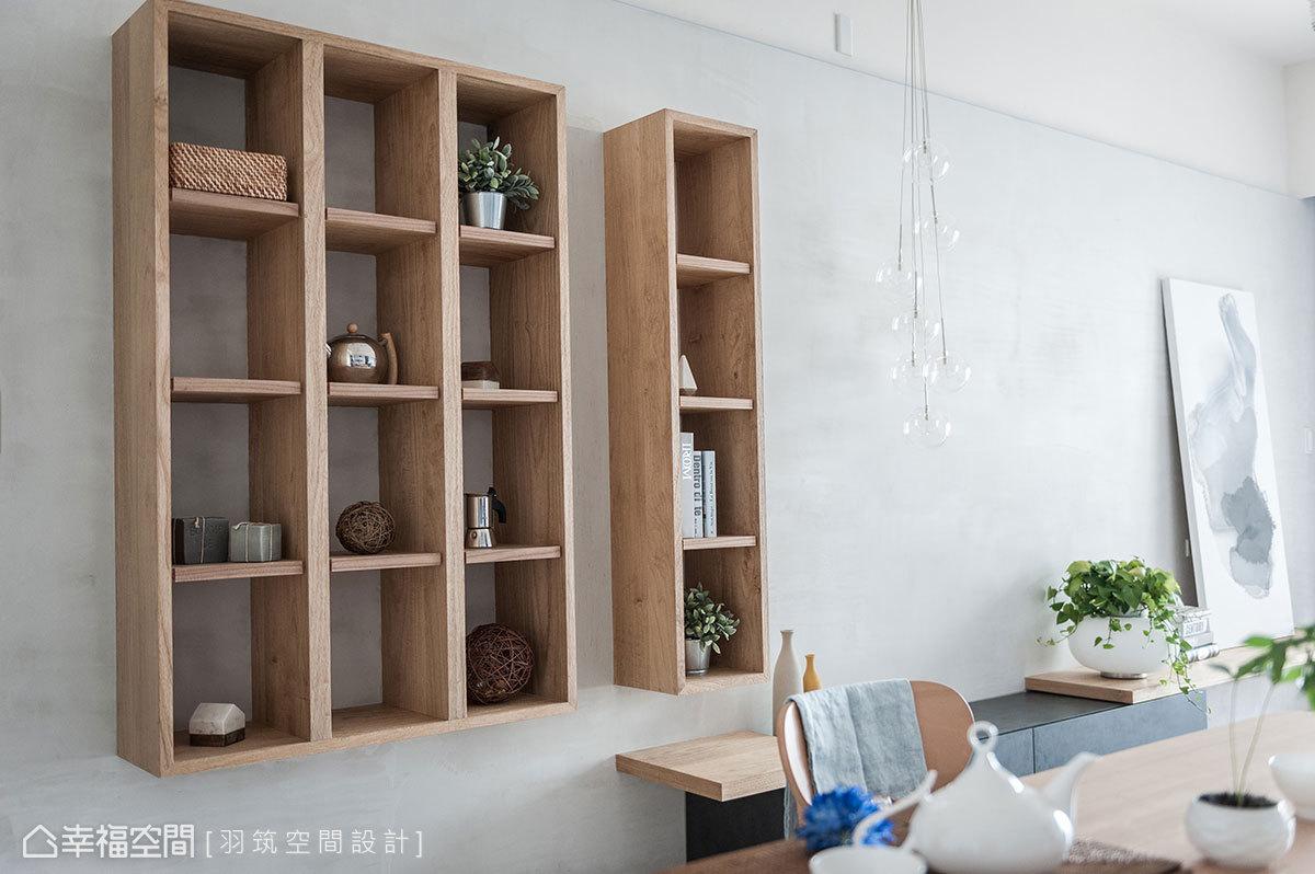 木作牆採仿清水模造型,帶來原始建築感;整齊劃一的展示格陳列風格單品,創造出零壓無負擔的收納方式。