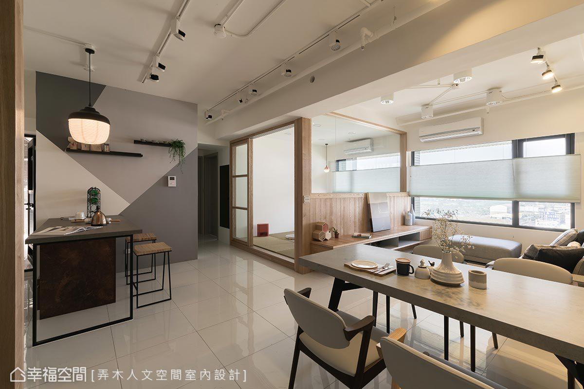 主牆以四色幾何圖形搭配台灣文創燈具鋪敘場域氛圍,並設置中島平台滿足實用機能,此處亦是屋主最佳的攝影場地。