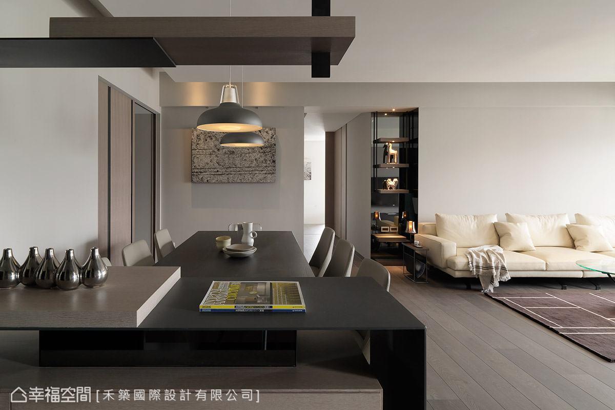 禾築國際設計利用半高矮櫃劃分玄關與餐廳領域,同時讓入門視野保持開闊。