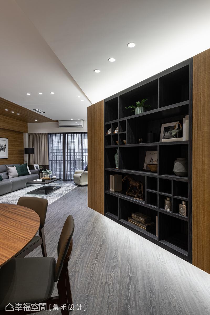 蔡林沖設計師適當揉入不規則語彙及灰階色彩點出現代時尚感,避免木質調淪為庸俗。