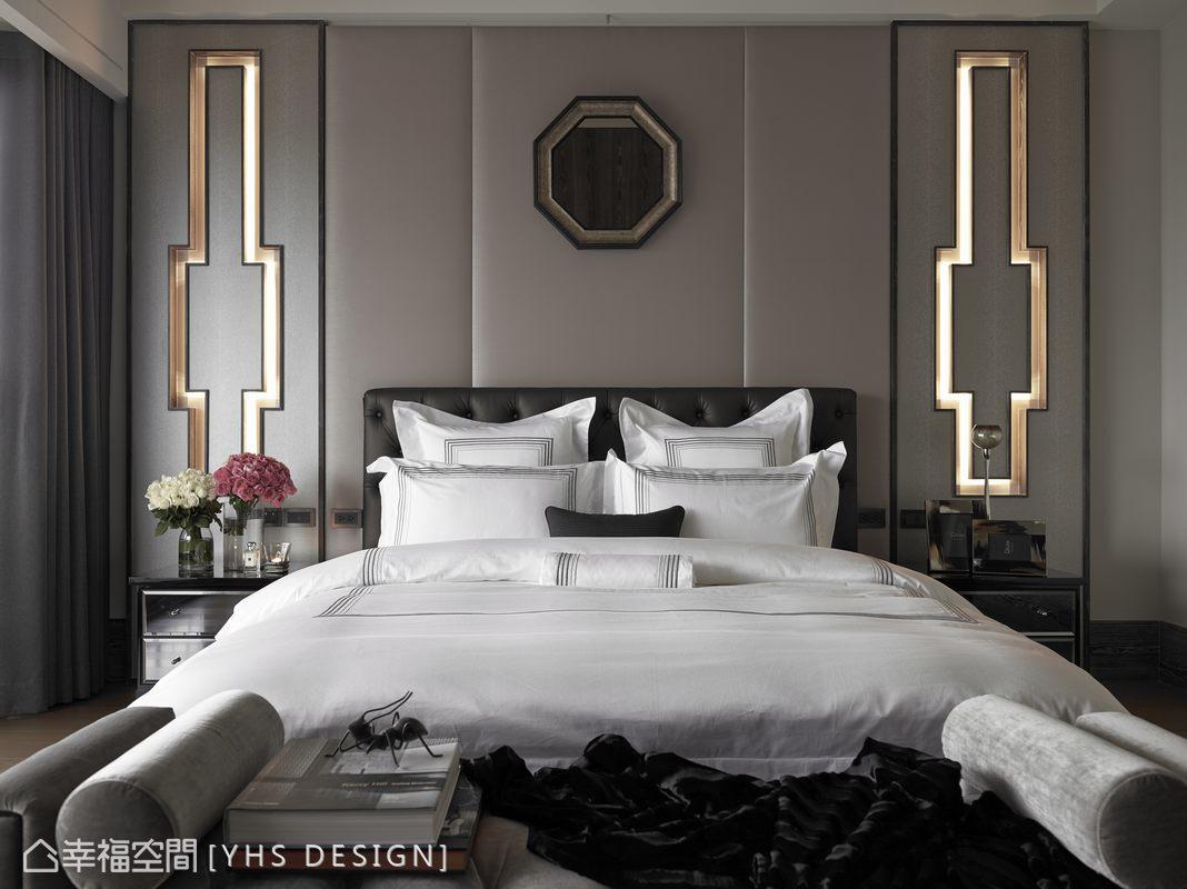 銀灰色珍珠魚皮豐富床頭材質的細膩層次,於對稱安定的視覺設計上,加入英式皇家十字圖騰元素,作為間接照明,八角形的仿古鏡點綴空間的大器質感。
